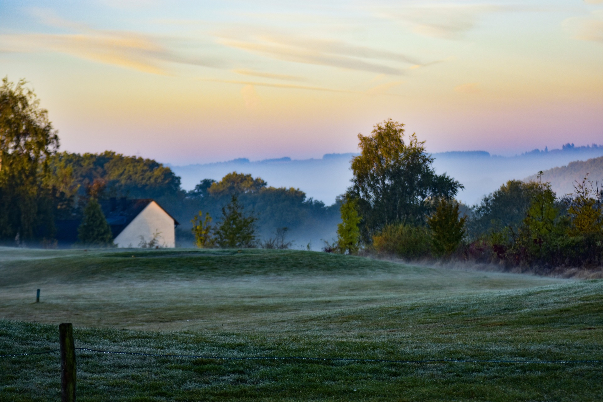 Scenic view of landscape at foggy morning