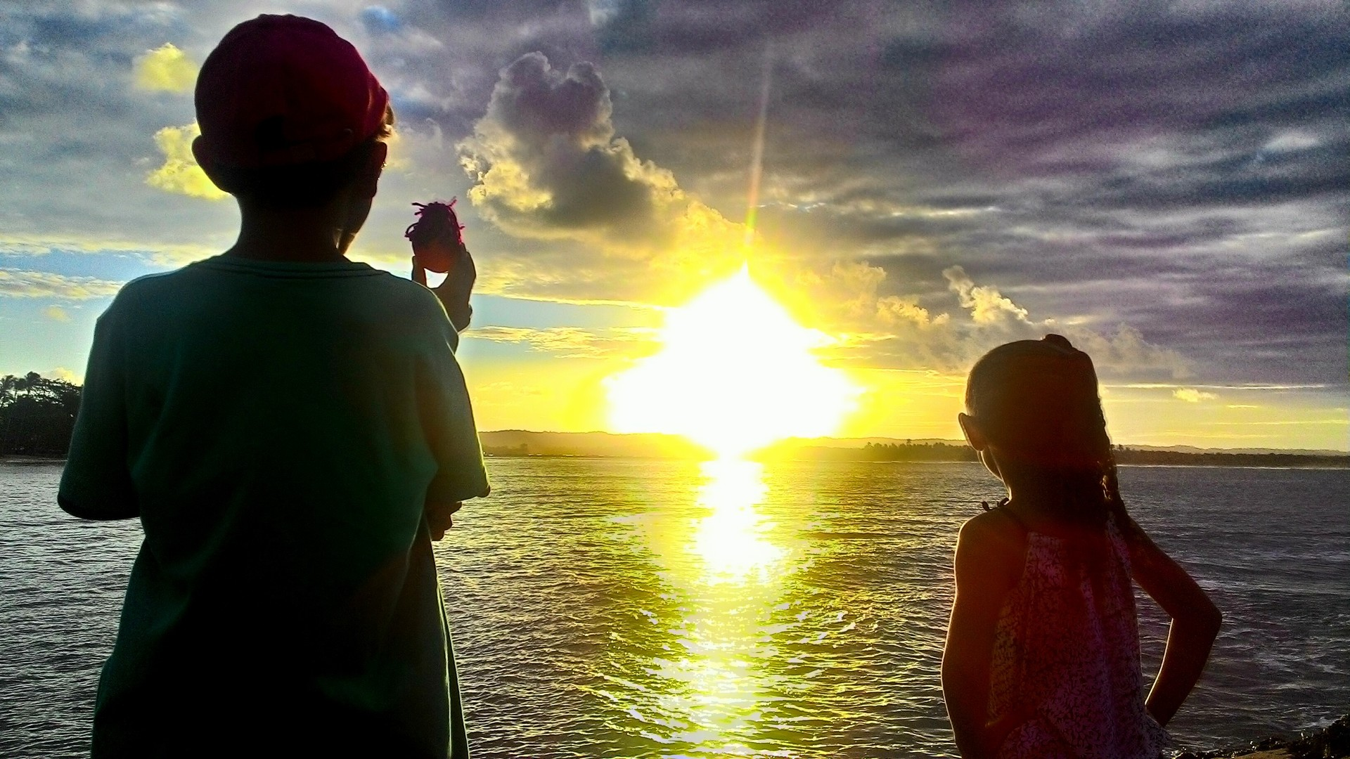 Sunset over sea with kids