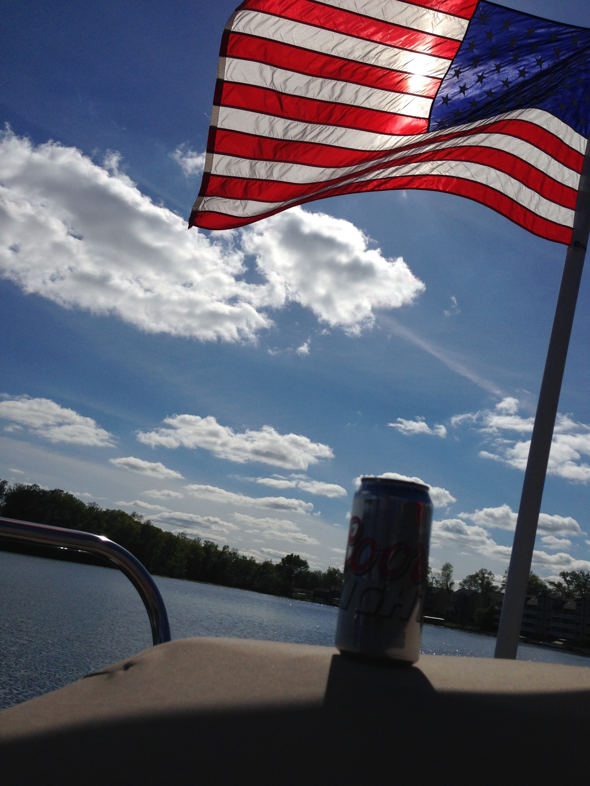 Old Glory. Summer fun on lake with drink and American flag