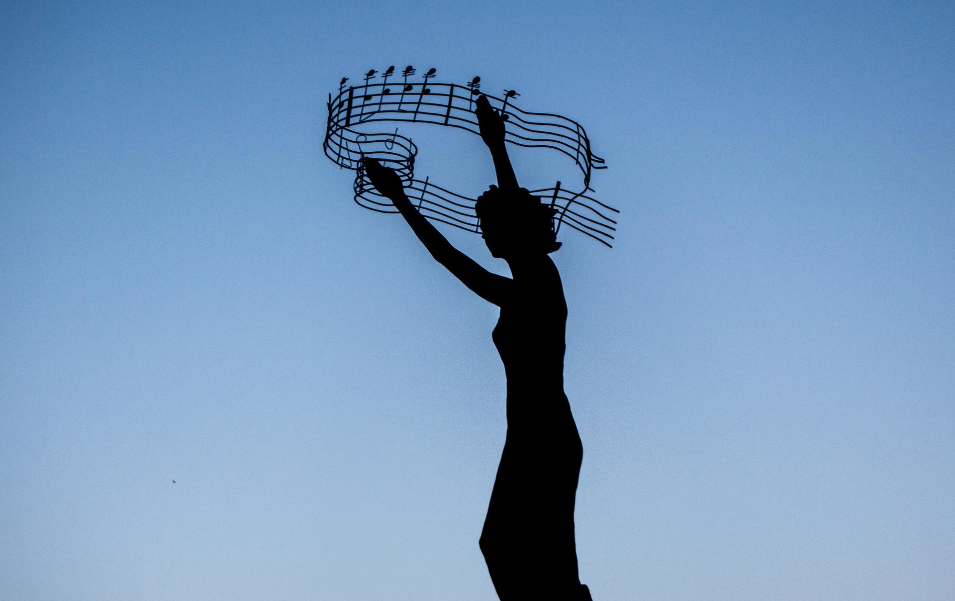 Music 🎵   woman, blue sky, light, outdoors