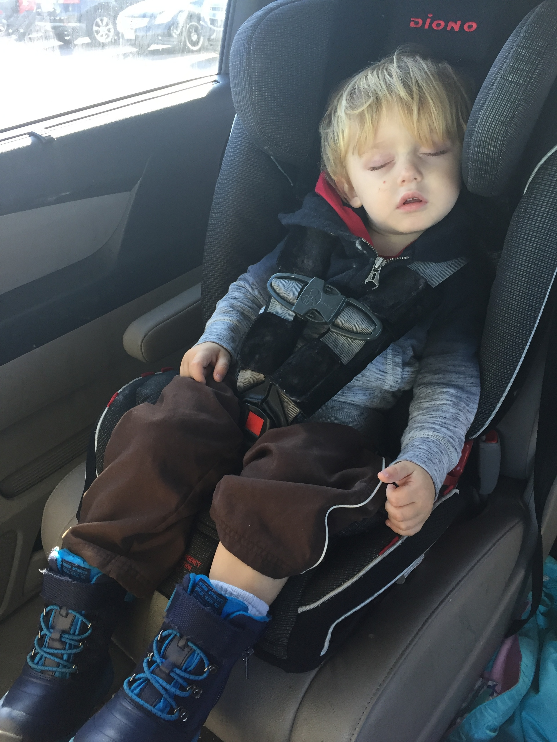 two year old little boy asleep in his car seat. Black Bedroom Furniture Sets. Home Design Ideas