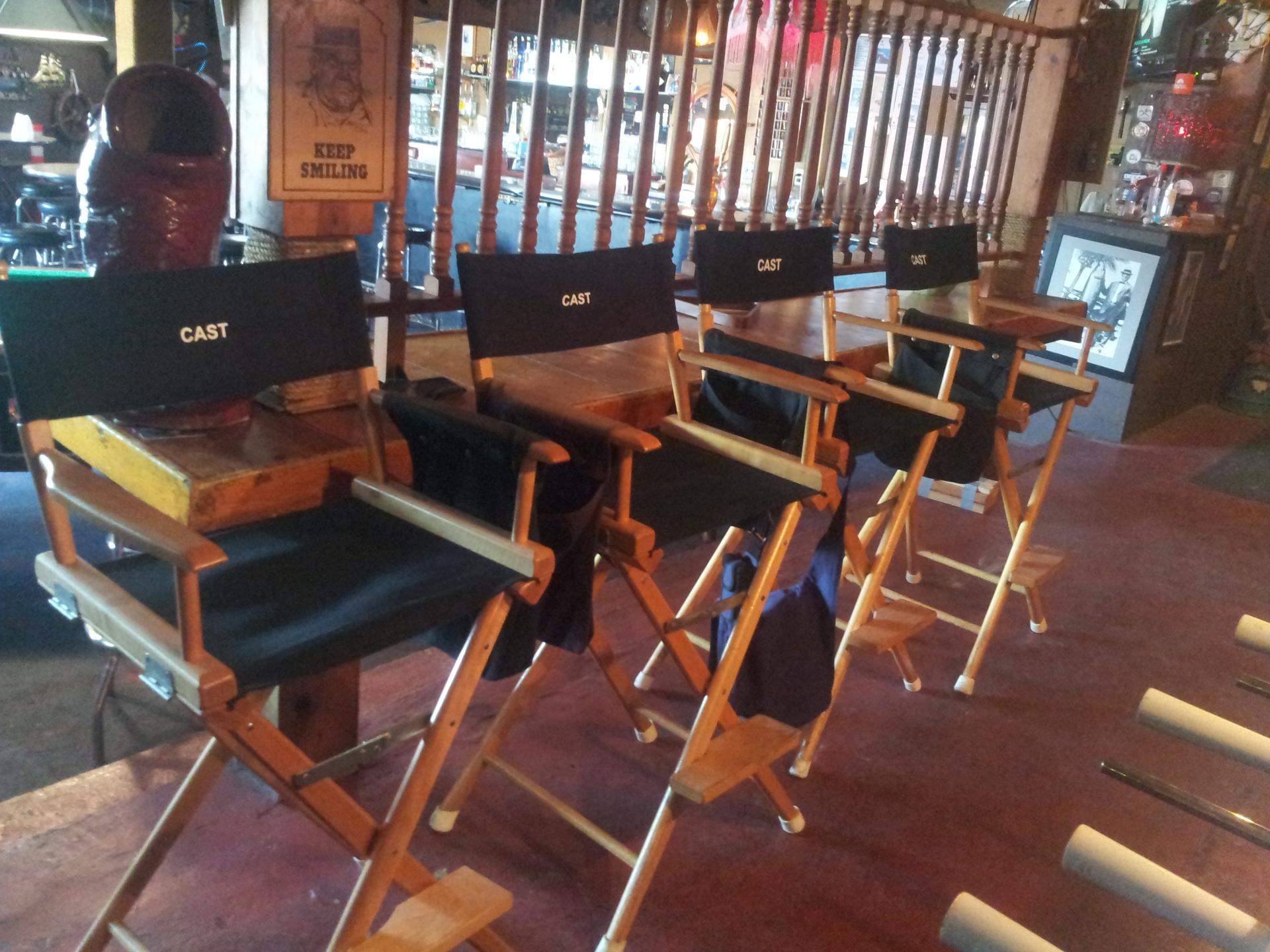 cast seats at a film set. cast seats seup prior to a filming at a local bar.